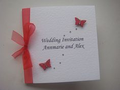Butterfly wedding invitation shown in red