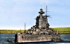Rare colour picture of 16 in battleship HMS Nelson in Scapa Flow, 1940. This class, cut down from a larger design as a result of the Washington Treaty, carried all 3 of their turrets forward.: