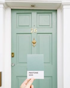 Pantone color swatches of real life beautiful minty green door somewhere in London