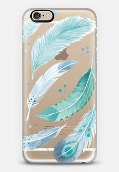 Transparent iPhone cases feature watercolor illustration of blue feathers by Four Wet Feet Studio