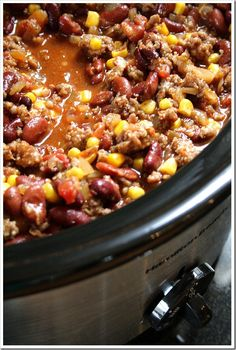 Firehouse Sausage Chili Recipe ~ Lots of tomatoes, lots of corn, lots of sausage, lots of beans – all combined to make a savory, spicy, perfectly seasoned winter time meal.