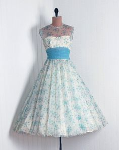 1950s spring dress styles - an otherwise strapless bodice overlaid with sheer fabric up to the neckline