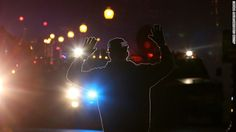 Its up 2 you 2  inform yourself!!! Know the facts! FERGUSON, MO - NOVEMBER 24:  A protestor stands in front of police vehicles with his hands up during a demonstration on November 24, 2014 in Ferguson, Missouri. A St. Louis County grand jury has decided to not indict Ferguson police Officer Darren Wilson in the shooting of Michael Brown that sparked riots in Ferguson, Missouri in August.