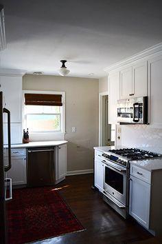 white cabinets, white silestone, white herringbone tile backsplash