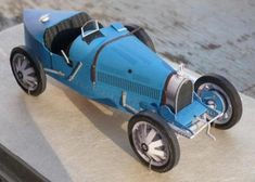Bugatti T35 Paper Model In 1/30 Scale - by Ichiyama  - == -  This is the Bugatti T35 in a really beautiful paper version created by designer Ichiyama. The model you see in the photo above wa sassembled by North American designer Thomas Meek.