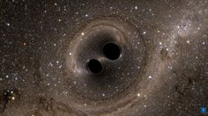 The collision of two black holes is seen in this image from a computer simulation released earlier this year.