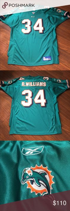 NFL Reebok Ricky Williams Miami Dolphins Jersey Ricky Williams Miami Dolphins Jersey Side 54.  Authentic NFL Equipment wear.  Side spandex gussets.  Tackle twill lettering, numbers and stitched nameplate.  This is a great quality Jersey, really well made.   Used twice then dry cleaned.   Barely used in great condition.  Go Dolphins!! Reebok Other
