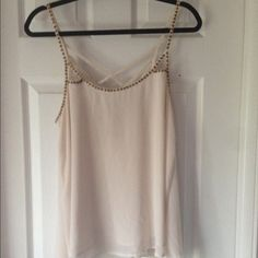 Forever 21 sleeveless top A flowy cream tank top from Forever 21 with strappy back and gold bead details. Forever 21 Tops Tank Tops