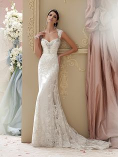 b4fc75684f Corded lace appliqué and tulle over soft satin slim A-line cage wedding  dress with lace cap sleeves