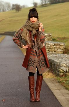 Graphic coat, leather boots, chunky scarf (and the hair!)