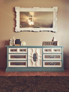 Multi colored dresser with silver hardware.