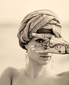 I have a new love affair with sepia toned portraits.  The striking henna tattoo doesn't hurt either :)