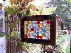 Suncatcher made from picture frame & glass gems.   use different glue for it to hold up outside.