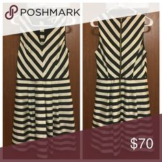 Banana Republic Black and White Striped Dress Satin black/cream striped dress with a slight sheen to the fabric. Runs true to size, not too low cut in the bust. Has hidden pockets on the seam! Looks good styled with a belt. Hits just above the knee. Worn to a few cocktail parties, in excellent condition. Banana Republic Dresses