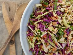 Colorful and crunchy Asian cabbage slaw. Scroll down to look at comments. Lots if good ideas for extras to add to the salad!