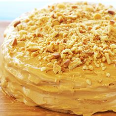 A delicious cake recipe with caramel icing and a touch of delicious toasted almond bits