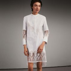 A straight fit shirt dress created from fine cotton in a variety of weaves, spliced with diaphanous scalloped lace. Side slits are cut high to accentuate the fluid silhouette.