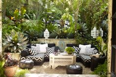 Moroccan Garden Patio: Inspired by Yves St. Laurent's Jardin Marjorelle in Marrakech, the structure and abundance of greenery on this patio are inspiring us to pour a glass of wine and commune with nature. (via Elle Decor) Backyard Seating, Garden Seating, Pergola Patio, Outdoor Seating, Backyard Patio, Backyard Ideas, Lounge Seating, Patio Ideas, Corner Seating
