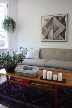 love the folded paper framed art  Cheap, Yet Chic: 8 Living Room Ideas for Little to No Money