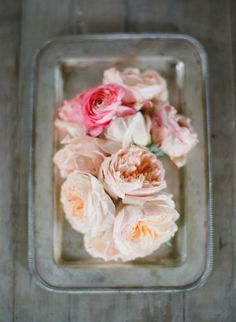Pink & peachy garden roses displayed on a tray.