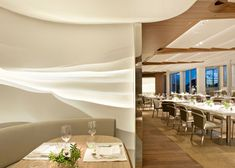 Louvred panels on ceiling with concealed lighting; wall feature - Bayerischer Hof Hotel, Munich, by Jouin Manku