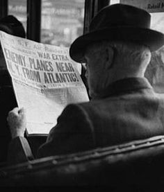 Reading newspaper about enemy planes, dec41