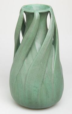 https://flic.kr/p/6gKG6F | Teco Pottery | Art pottery vase, c. 1915 Made by Gates Potteries  Around 1885, William Day Gates established Gates Potteries in Crystal Lake, Illinois. After years of trial and error, he developed a cool, silvery green matte glaze that resembled the tones of aged bronze. Combining the first letters of the words terra and cotta, Gates named the new pottery Teco and began selling the line in 1900. In addition to using his own designs, Gates enlisted progressive…