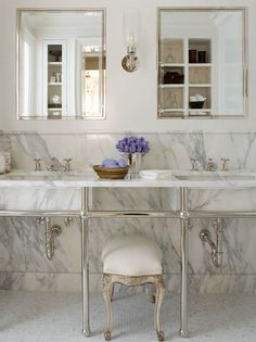Stunningly simple and beautiful marble and nickle master bathroom by the great-and-powerful Phoebe Howard.
