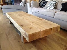 Neat Coffee Table made from ceiling beams.       What to do with leftover ceiling beams? Probably make rustic tables.