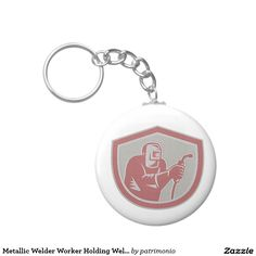 Metallic Welder Worker Holding Welding Torch Shiel Keychain. Keychain designed with a metallic styled illustration of a welder holding a welding torch viewed from front set inside a shield on isolated background done in retro style. #welder #welding #keyring #keychain
