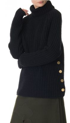 This turtleneck pullover is spun from luxuriously soft merino wool with button details at the side seam and ribbed edges for texture. Cut for a loose, oversized fit, this cozy sweater looks great opposite relaxed pants and skirts alike. Ribbed edges. Unlined.    Black styled with Valia Cut Out Applique Skirt and Rachel Boots. Heather Burlap styled with Agathe Wrap Tie Culottes and Dakota Boots.   100% Merino Wool. Professional Dry Clean Only.  Style Number: TF216RBS64643  Available in…