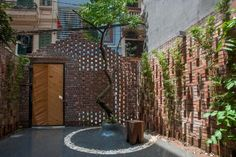 A perforated brick screen shields a verdant courtyard at the entrance to this small two-storey house in Hanoi, Vietnam, designed by local studio Nghia Architect. Architects Journal, Cabinet D Architecture, Green Architecture, Architecture Design, Casa Patio, Concrete Bricks, Concrete Floor, Two Storey House, Hanoi Vietnam