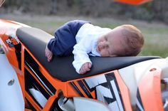 Baby on a KTM dirtbike