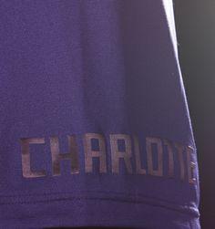 "SHORTS · Purple ""Charlotte"" tone-on-tone on bottom right leg"