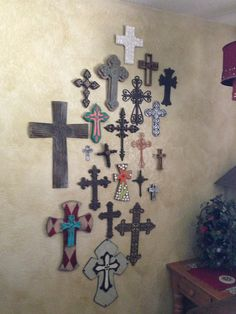 this is how I displayed my crosses along the wall going up my living room staircase. Lovely!