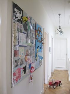 a huge bulletin board in the hall in a collage style ?? love!