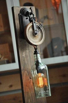 Steampunk recycled Bottle Sconce with Pulley from Moonshine Lamp Co Rustic Lighting, Industrial Lighting, Vintage Lighting, Cool Lighting, Industrial Lamp Shade, Steampunk House, Steampunk Lamp, Pulley Light, Lamp Light