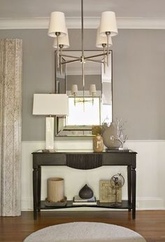 Like the grey/white with dark furniture & silver accents