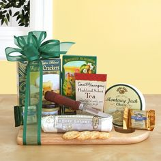 Cheeseboard Complete  This gourmet meat and cheese assortment is a delectable gift loaded with savory delights! Gourmet goodies are beautifully presented upon a wooden cutting board, including: Summer sausage, cheese, water crackers, California smoked almonds, Napa Valley mustard, Ghirardelli Squares, Hemingway tea and a cheese knife.  Ships from CA within 2-5 days Delivery   Order Today: http://kjevonc.labellabaskets.com/