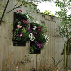 Lovely for small spaces. A vertical garden suitable for hanging outdoors, the Verti-Plant is made of a heavy duty, non woven material and has drainage holes in the top three pockets; it's £12.95.
