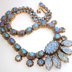 "RARE Vintage Schiaparelli Lava Rock Carnival Art Glass Blue Rhinestone Necklace. BEAUTIFUL vintage art glass and rhinestone necklace by Schiaparelli. The necklace features amazing iridescent icy blue ""lava rock"" art glass stones, b"