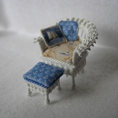 Quarter scale miniature wicker chair and foot stool by CherylHubbardMinis on Etsy Stool Cushion, Seat Cushions, White Wicker Chair, Beige Background, Blue Fabric, Rocking Chair, Blue Backgrounds, Cheryl, Printing On Fabric