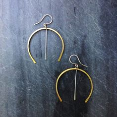 Hammered brass and silver wishbone earrings by Loop now at https://squareup.com/market/ConceptFortySeven