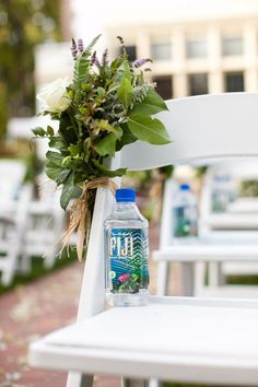 What a great idea to put a bottle of water on each chair for a summer ceremony