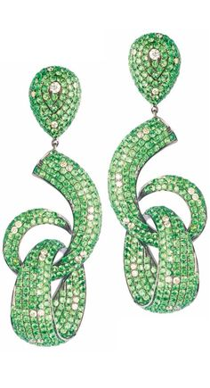 Tsavorite and Diamond Earrings by Goldesign.  These would look so lovely against her neck.