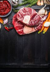 Veal shank slices meat and ingredients for Osso Buco cooking stock photo