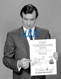 DAVID JANSSEN HOLDING A POSTER FOR TUBERCULOSIS CHRISTMAS SEALS, B&W PHOTO!! in Collectibles, Photographic Images, Contemporary (1940-Now) | eBay
