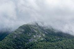 Fog setting on a rugged mountain ridge in Bergen