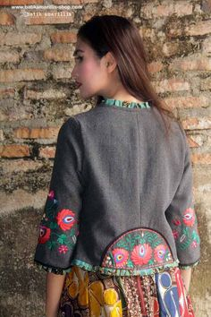 batik amarillis's parisian walkways jacket add polish to your tailored wardrobe! such fitted and chic jacket with quirky twist! accented with panelled detailing & contrast trims plus 3 quirky pockets! in cotton twill adorned with meticulous Hungarian folk art embroidery and batik piping .