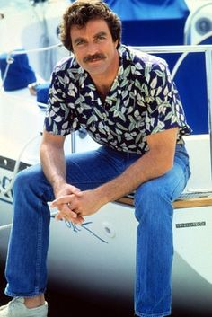 """Tom Selleck, wearing an 'aloha shirt,' played a Hawaii-based private investigator in """"Magnum, P.I.' from 1980 to 1988. What a hunk!!"""